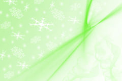 Beautiful light green blurred background with. Picture of light green blurred background with white snowflakes on it. Festive winter theme with motion effect Royalty Free Stock Photo