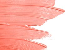 Living Coral colored smear of paint texture royalty free stock photos