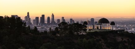Beautiful Light Los Angeles Downtown City Skyline Urban Metropol. Green trees dominate the forground with the city skyline of Los Angeles in the background Stock Images