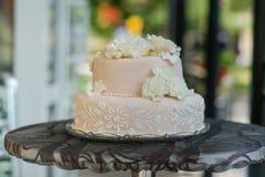 Beautiful light pink and tasty wedding cake Royalty Free Stock Photo
