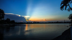 The beautiful light shining behind the cloud Stock Photo
