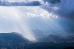 Light shine at mountain panoramic view. Beautiful light shining through cloud on rain forest mountain view. Landscape in  Chiangmai, Thailand at  Doi Intanond Royalty Free Stock Images