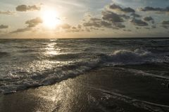 The Surf Rolling in at Sunrise stock images