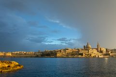 Beautiful light on Valletta after the storm cleared. Beautiful light on Valletta after the storm has cleared and passed royalty free stock image