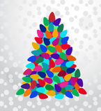 Beautiful lightbulb Christmas  tree. In a variety of colors over abstract background (Layered and grouped for easy selection Royalty Free Stock Photos