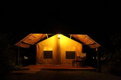 A beautiful lighted tent at Ol Pejeta Conservancy, Kenya. A beautiful tent for night stay during Safari trip Royalty Free Stock Photography