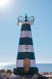 Beautiful lighthouse with calm ocean water background. sunny day outdoors Stock Photography