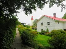 A beautiful lighthouse and the lighthouse keepers Home along the royalty free stock photos
