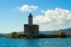 A beautiful lighthouse. In the middle of the sea Stock Photo