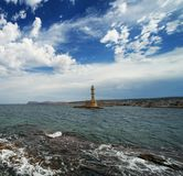 Beautiful lighthouse over  cloudy sky Stock Image