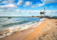 Beautiful lighthouse on the sea coast stock photo