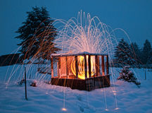 Beautiful lighting and fireworks inside wood cabin Royalty Free Stock Photography