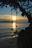 Beautiful lighting landscape and cloud before sunset , Wooden swing under the tree on Long beach, Koh Chang isla Stock Photos