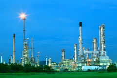 Beautiful lighting of oil refinery industry estate plant with fr Stock Photos