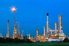 Beautiful lighting of oil refinery palnt against dusky blue sky. Of oil refinery plant in heavy petrochemical industry estate Royalty Free Stock Photo