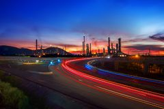 Beautiful lighting of oil refinery plant. Petrochemical industry with transport Royalty Free Stock Photography