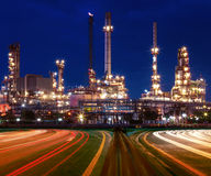 beautiful lighting of oil refinery plant in industry estate against blue sky of night stock photo
