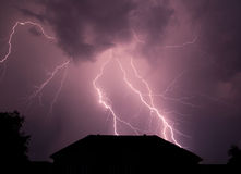 Beautiful lightning disturb the quiet country life. Royalty Free Stock Photo