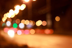 Beautiful lights of the night streets. Beautiful lights of the night streets with bokeh effect Stock Photos