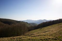 Ligurian Apennines landscape in springtime at sunset. Beautiful ligurian Apennines landscape with forest and tops of mountains in springtime at sunset Stock Photos