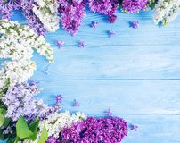 Beautiful lilac flower pattern seasonal arrangement on wooden background celebration frame. Beautiful lilac flower wooden background frame celebration stock photography