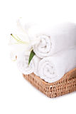 Beautiful lilly on towels rolls Royalty Free Stock Images