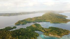 Aerial View of Beautiful Islands in Raja Ampat. Beautiful limestone islands, surrounded by healthy coral reefs, are found in Yangeffo, Raja Ampat, Indonesia stock video footage