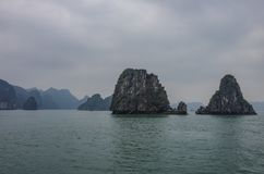 Beautiful limestone mountain scenery at Ha Long Bay, North Vietnam. Foggy weather in winter day. stock photography