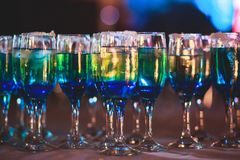 Beautiful line of different colored alcohol cocktails with smoke on a Christmas party, tequila, martini, vodka, and others on part Stock Photography