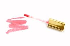 Beautiful lip gloss, isolated on white. Beautiful lip gloss, isolated on white Royalty Free Stock Photos