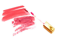 Beautiful lip glosses, isolated on white. Stock Photos