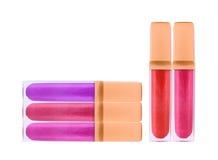 Beautiful lip glosses, isolated on white Stock Image