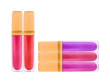 Beautiful lip glosses, isolated on white Royalty Free Stock Image