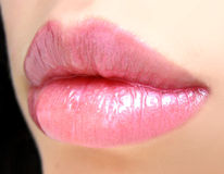 Beautiful lips. Rose brilliant pomade on lip Stock Photo