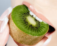 Beautiful lips and delicious kiwi Stock Image