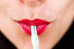 Beautiful lips with straw Stock Images