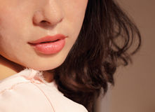 Beautiful lips. The woman`s beautiful lips slightly open Stock Image