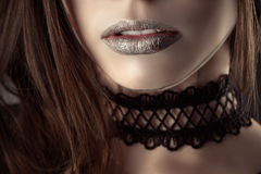 Beautiful lips young girl with fashion choker. Closeup Royalty Free Stock Image