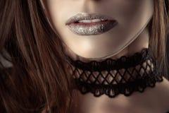 Beautiful lips young girl with fashion choker. Closeup royalty free stock image
