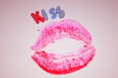 Beautiful lipstick kiss. Red kiss lips stamped on a paper Stock Photos