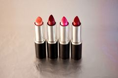 Beautiful lipsticks, cosmetics and make-up. A still life of a set of colourful lipsticks Stock Photos