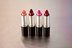 Beautiful lipsticks, cosmetics and make-up. A still life of a set of colourful lipsticks stock photos