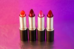 Beautiful lipsticks, cosmetics and make-up series. A still life of a set of colourful lipsticks Royalty Free Stock Photography