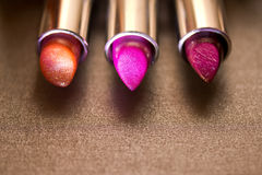 Beautiful lipsticks -the make-up series. A still-life of some colorful lipstick stock photography