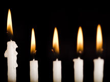 Beautiful lit hanukkah candles on black. stock image