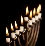 Beautiful lit hanukkah menorah on black. stock images