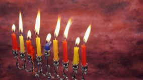 Beautiful lit hanukkah menorah on black background. stock footage
