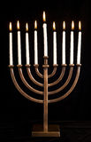 Beautiful lit hanukkah menorah on black velvet. Royalty Free Stock Image