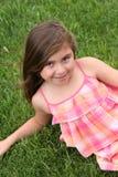Beautiful litte hispanic girl in grass Stock Images