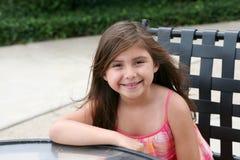 Beautiful litte hispanic girl at table Stock Photography